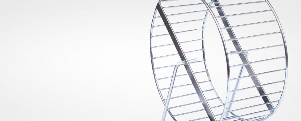Gefangen im Hamsterrad Stress Burnout Prävention Hamsterrad aus Stahl