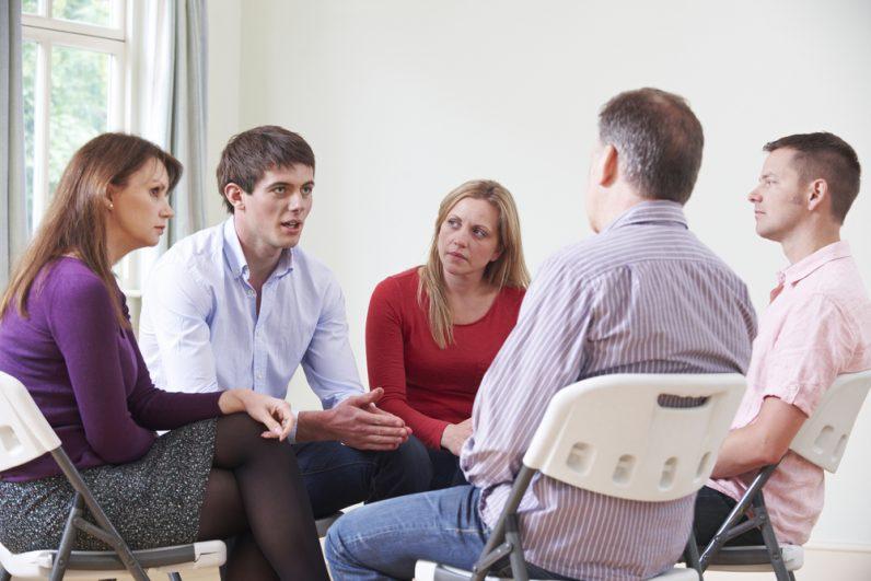 Seminare gegen stress und burnout Gruppe redet
